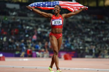 Carmelita Jeter winning silver in the Women's 100m Final- in her first Olympics!
