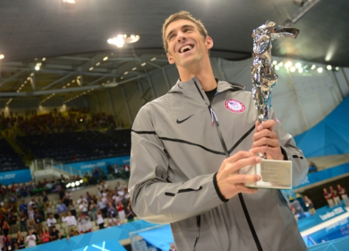 Michael Phelps getting called back to the podium by the governing body of swimming, FINA, to receive a trophy commemorating his standing as the most decorated Olympian ever!! :)