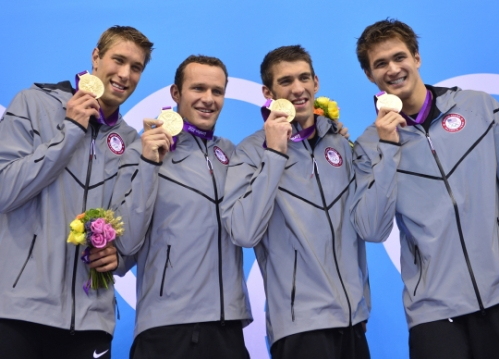 Matthew Grevers, Brendan Hansen, Michael Phelps, and Adrian Nathan winning gold in the men's 4x100 medley relay. Phelps' last Olympics race making his total medal count 22, with 2 bronze and silvers and 18 gold medals!