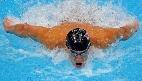 Michael Phelps winning gold in the men's 100-meter butterfly final- his last Olympic individual race