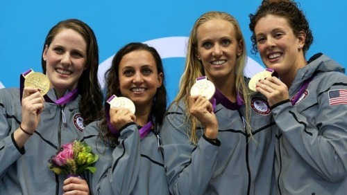 Missy Franklin, Rebecca Soni, Dana Volmer, and Allison Schmitt set a world record to win gold in the 4x100-meter medley relay, the last women's race of the games